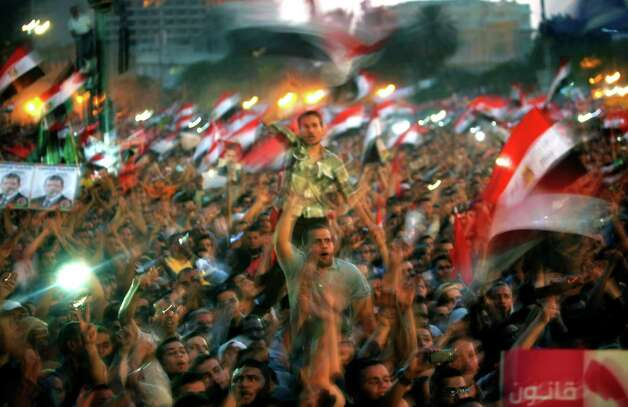 Egyptian Muslim Brotherhood supporters chant anti-ruling military council slogans during a mass demonstration in Tahrir Square, Cairo, Egypt Tuesday, June 19, 2012. The campaign of Hosni Mubarak's former prime minister said on Tuesday he has won Egypt's presidential election, not the rival Muslim Brotherhood's candidate, opening a potential fight for the post and adding a new layer to the country's unrest and political power struggles.   (AP Photo/Nasser Nasser) Photo: Nasser Nasser