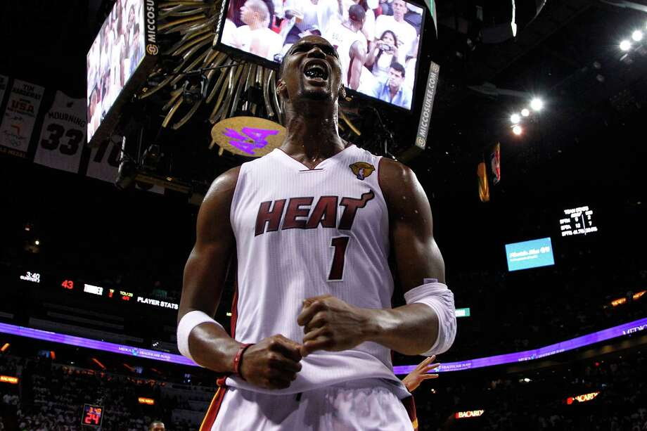 MIAMI, FL - JUNE 19:  Chris Bosh #1 of the Miami Heat reacts in the second quarter against the Oklahoma City Thunder in Game Four of the 2012 NBA Finals on June 19, 2012 at American Airlines Arena in Miami, Florida. NOTE TO USER: User expressly acknowledges and agrees that, by downloading and or using this photograph, User is consenting to the terms and conditions of the Getty Images License Agreement. Photo: Mike Ehrmann, Getty Images / 2012 Getty Images