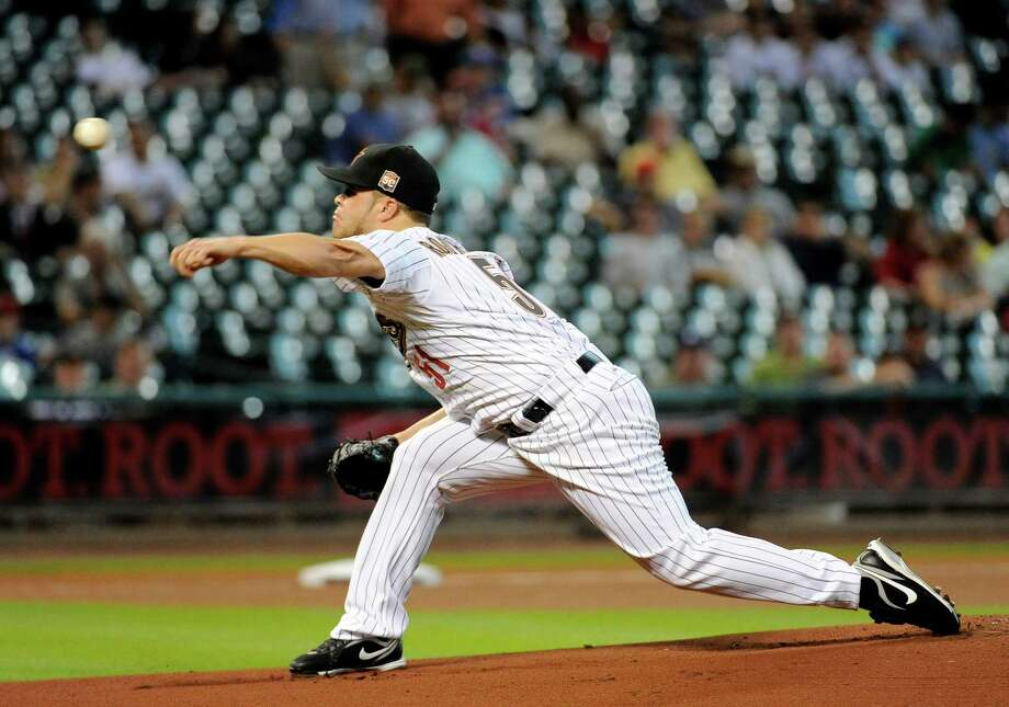 Houston Astros' Wandy Rodriguez releases a pitch against the Kansas City Royals in the second inning of a baseball game, Tuesday, June 19, 2012, in Houston. Photo: AP