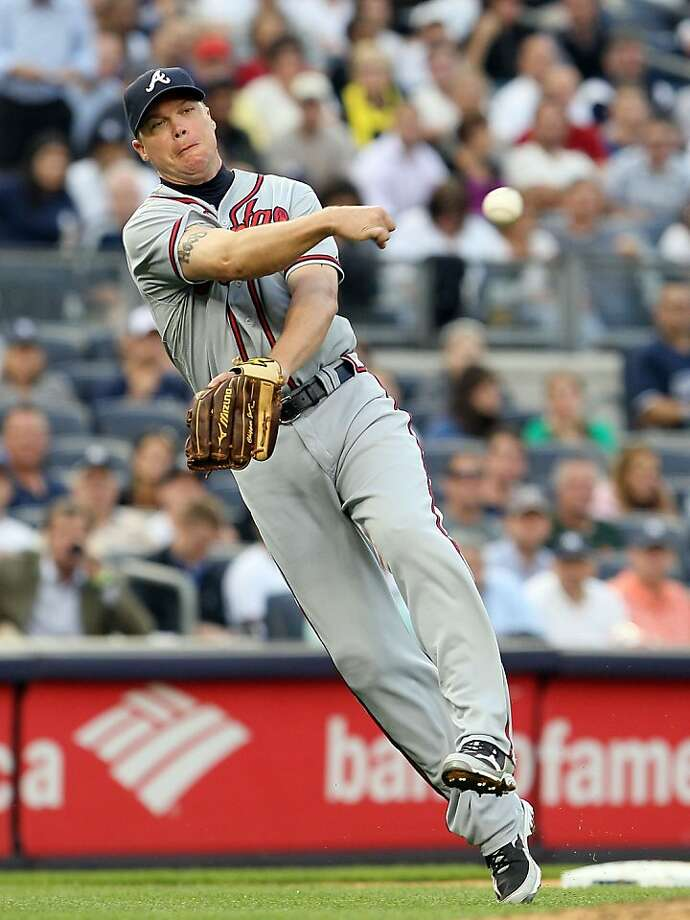 NEW YORK, NY - JUNE 19:  Chipper Jones #10 of the Atlanta Braves throws out Russell Martin #55 of the New York Yankees (not pictured) in the second inning at Yankee Stadium on June 19, 2012  in the Bronx borough of New York City.  (Photo by Jim McIsaac/Getty Images) Photo: Jim McIsaac, Getty Images