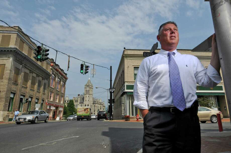 Cohoes Mayor John T. McDonald III stands on Tuesday June 19, 2012, at the intersection of Ontario and Remsen streets, where cameras will be installed to keep an eye on city intersections as crime-fighting tools in Cohoes, NY. The camera will hang next to the traffic lights visible over the intersection.  (Philip Kamrass / Times Union) Photo: Philip Kamrass / 00018153A