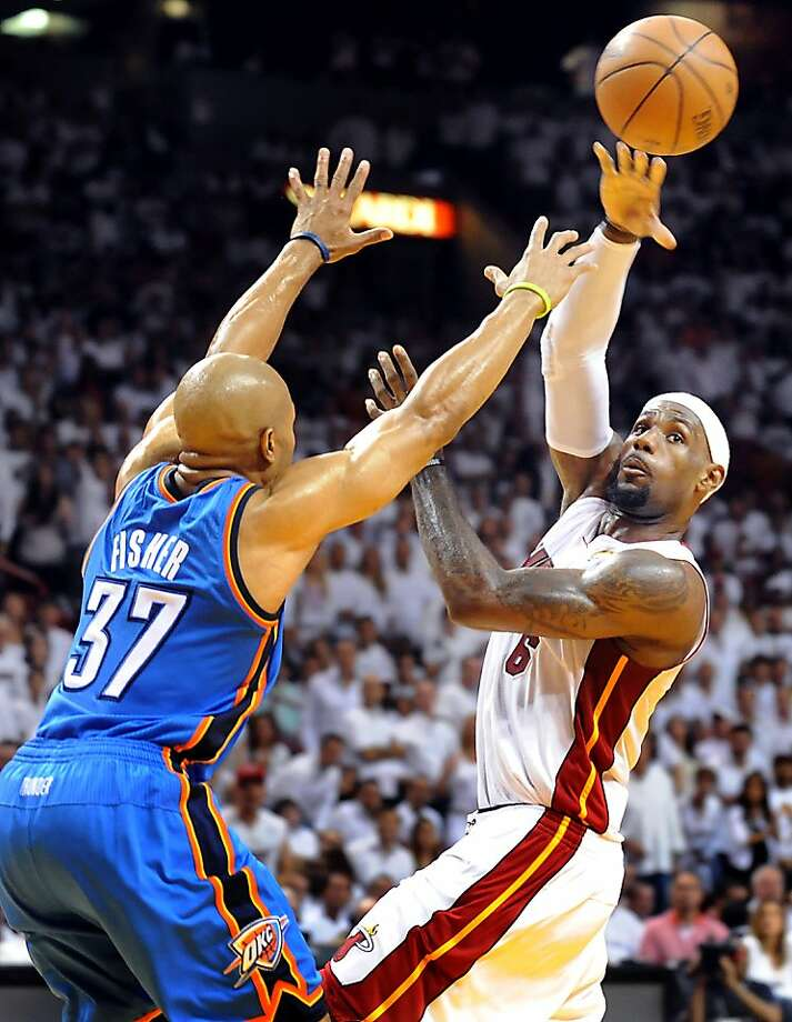 LeBron James of the Miami Heat passes the ball while being guarded by Oklahoma City Thunder's Derek Fisher in the second quarter during Game 4 of the NBA Finals at the AmericanAirlines Arena in Miami, Florida, Tuesday, June 19, 2012. (Robert Duyos/Sun Sentinel/MCT) Photo: Robert Duyos, McClatchy-Tribune News Service