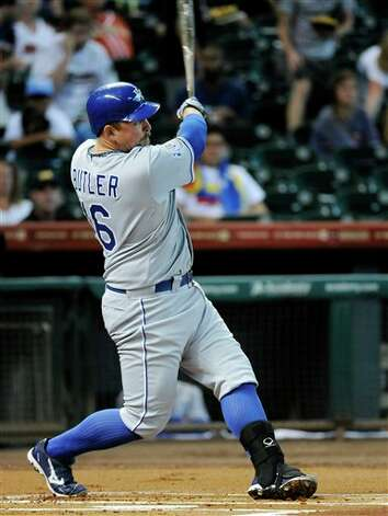 Kansas City Royals' Billy Butler watches the ball go over the wall for a solo home run against the Houston Astros in the first inning of a baseball game, Tuesday, June 19, 2012, in Houston. (AP Photo/Pat Sullivan) Photo: Associated Press