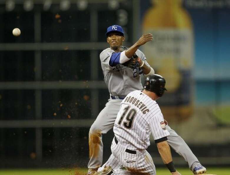Kansas City Royals shortstop Alcides Escobar (2) makes the out on Houston Astros right fielder Brian