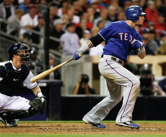 Texas Rangers' Josh Hamilton watches his second consecutive hit to start a three run Rangers' rally against the San Diego Padres during the sixth inning of an interleague  baseball game Tuesday, June 19, 2012 in San Diego. (AP Photo/Lenny Ignelzi) Photo: Associated Press