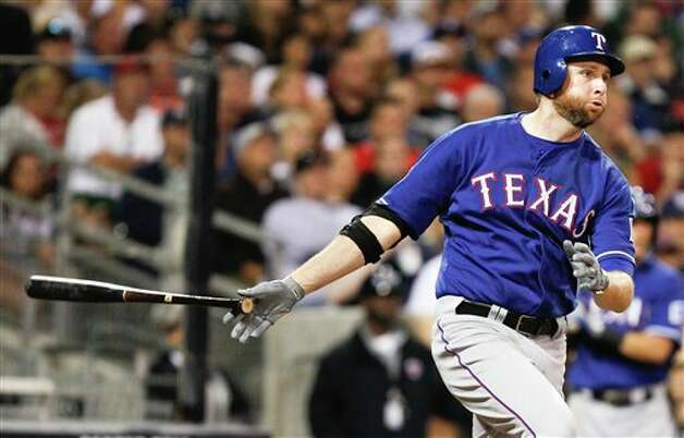 Texas Rangers pitcher Scott Feldman drives an RBI single down the right field line against the San Diego Padres during the sixth inning of an interleague  baseball game Tuesday, June 19, 2012 in San Diego. (AP Photo/Lenny Ignelzi) Photo: Associated Press