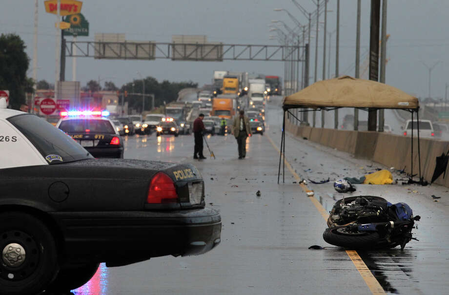 San Antonio police investigate the scene of a fatal motorcyle accident Wednesday June 20, 2012 on IH-35 northbound at Southcross Boulevard. Sgt. Bobby Bradley said witnesses saw the motorcycle speeding on the highway's northbound lanes between Southwest Military Drive and West Southcross Boulevard before he passed a vehicle and then collided with a pickup about 6 a.m. The interstate highway was shut down until about 7:30 a.m. John Davenport/San Antonio Express-News Photo: San Antonio Express-News