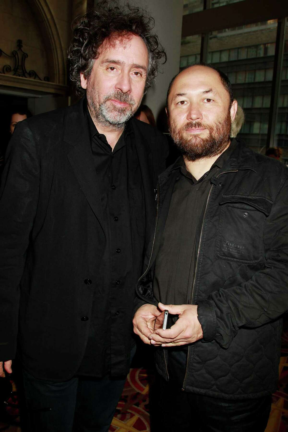 This image released by Starpix shows producer Tim Burton, left, and director Timur Bekmambetov at the premiere of Twentieth Century Fox film,