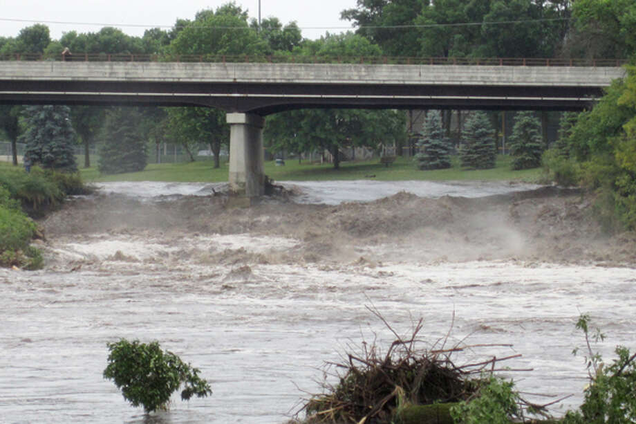 The water rises on Little Cannon River on Friday, June 15, 2012 in Cannon Falls, Minn. Residents in roughly two dozen homes were asked to evacuate after heavy rains sent the Cannon River and the Little Cannon River rising, while residents in the southern part of Goodhue County were cleaning up damage caused by winds ranging from 60 to 80 mph. Photo: .
