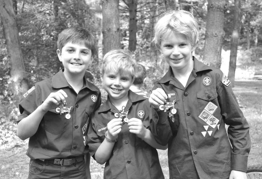 On July 12, Greenwich Scouting celebrates the official Centennial Anniversary of their charter by the Boy Scouts of America.  Every event for Scouts has been special this year in honor of the Centennial, including the BMX Cuboree when Cub Scouts raced their bikes. From left to right at the Cuboree are Declan Long, Charlie and Christopher Benincasa, all from Boy Scout Pack 10. Photo: Contributed Photo