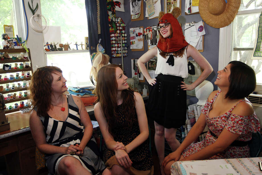 Nerd Alert Designs' from  left, Crissy Baker, Sofi Leggett, Kathy Baker and Amanda Guerra Deibel, joke around, Sunday, June 17, 2012. The group of women specialize in making retro clothing and geeky chic clothing. Kathy Baker was trying on part of the Chewbacca/Ewok dress. Photo: Jerry Lara, San Antonio Express-News / © 2012 San Antonio Express-News