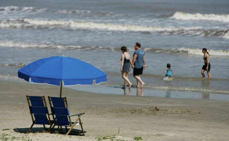Walk the beach in Galveston, then go for a swim. Photo: Melissa Phillip / Houston Chronicle
