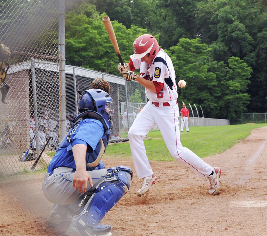 David Berdoff of the Greenwich Cannons gets hit by a Thomas Carruthers pitch in the bottom of the first inning during Senior American Legion Baseball game between the Greenwich Cannons vs Darien/New Canaan at Greenwich High School, Tuesday, June 19, 2012. Photo: Bob Luckey / Greenwich Time
