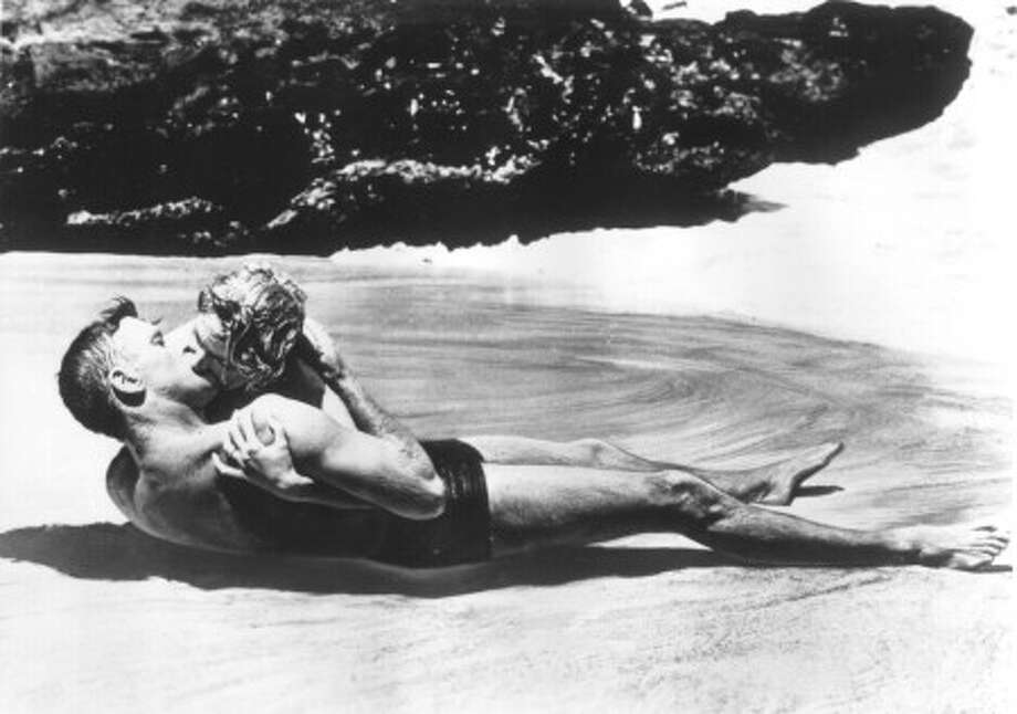 FROM HERE TO ETERNITY -- Deborah Kerr and Burt Lancaster.  Not exactly sex, but we get the idea.