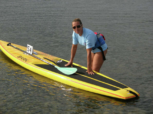 Louisa Lima will bring the water sport of standup paddleboarding to Bayley Beach this summer. Photo: Contributed Photo / CT