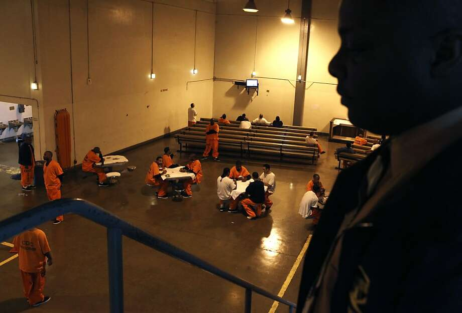 Inmates at San Quentin Prison play cards and watch TV in the recreation area of the gymnasium floor that houses over three hundred inmates Wednesday Nov 24, 2010.  Gov. Arnold Schwarzenegger recently announced that the state has contracted to ship 5,800 more prisoners out of state. The no-bid contracts with two private prison companies will increase the number of prisoners in out-of-state to more than 15,000 -- and locks the state into these contracts for years. Photo: Lance Iversen, The Chronicle