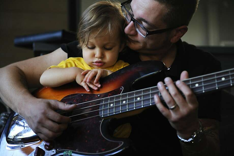 Kylee Swenson and Anthony Gordon are the lead singer and guitarist and base player in the Oakland band, Loquat, as well as parents of an eighteen month old toddler, Braxton. Braxton joins their practice session on Wednesday, June 13, 2012 at their home in Oakland Hills, in Oakland, Calif. Photo: Megan Farmer, The Chronicle