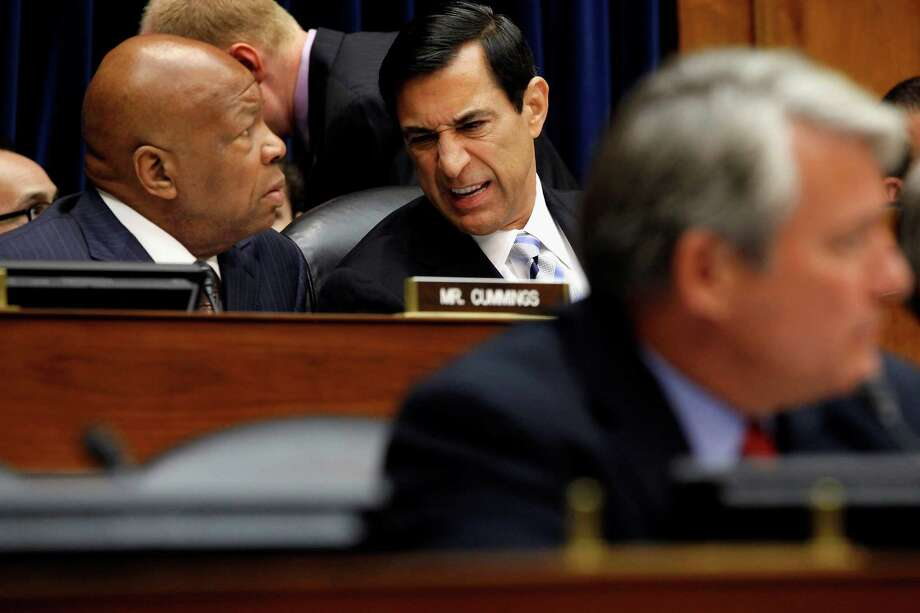 Darrell Issa, R-Calif. (center), talking to Elijah Cummings, D-Md., heads the House Oversight and Government Reform Committee, which voted 23-17 to hold Eric Holder in contempt. Photo: Chip Somodevilla, Getty Images / 2012 Getty Images