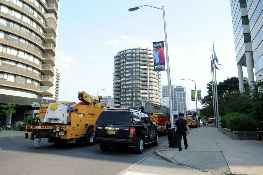 Emergency vehicles line the streets outside Government Center after a transformer near the garage blew up resulting in heavy smoke and the evacuation of Government Center on Wednesday, June 20, 2012. Photo: Lindsay Niegelberg / Stamford Advocate