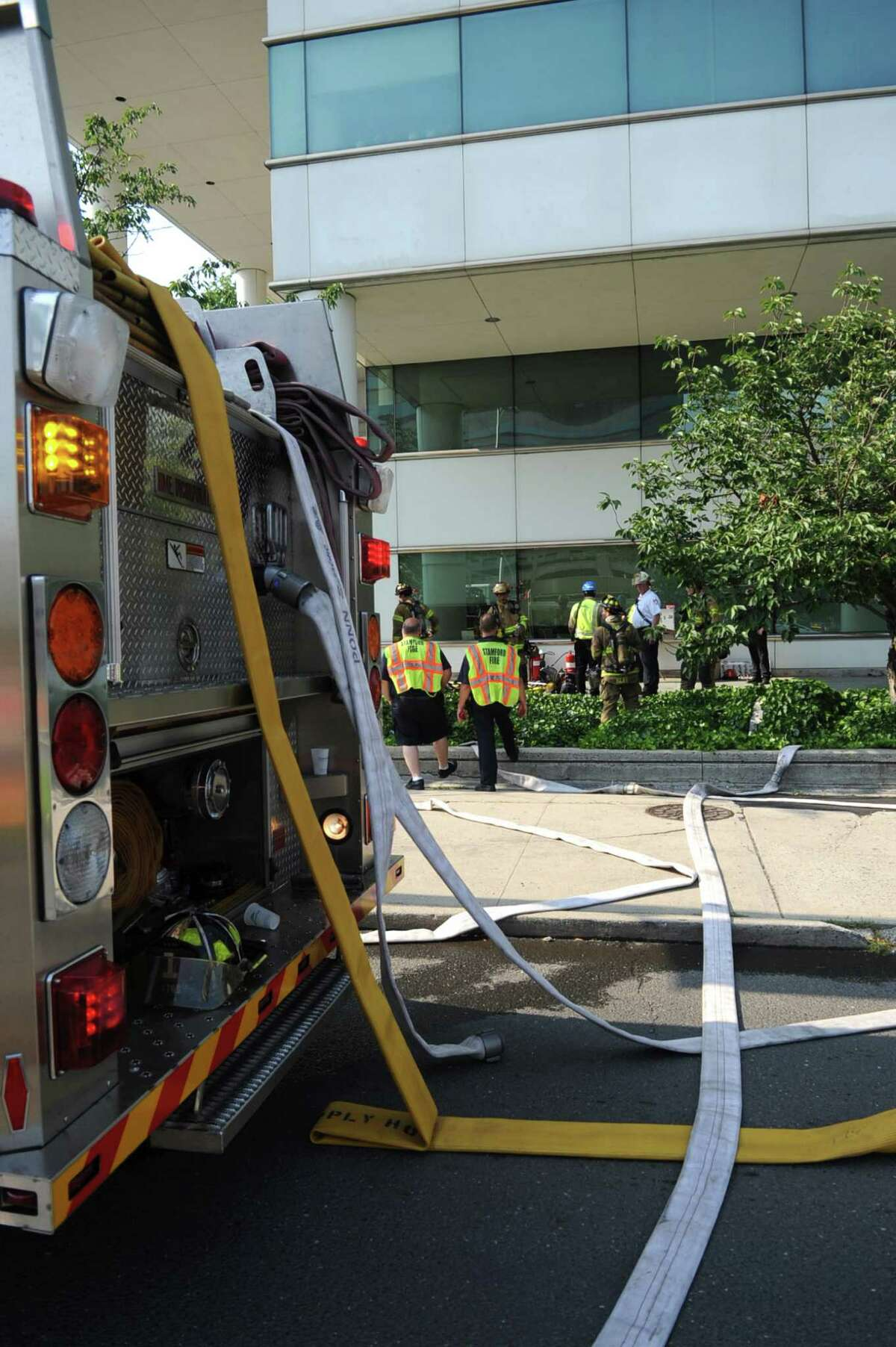 Emergency vehicles line the streets outside Government Center after a transformer near the garage blew up resulting in heavy smoke and the evacuation of Government Center on Wednesday, June 20, 2012.
