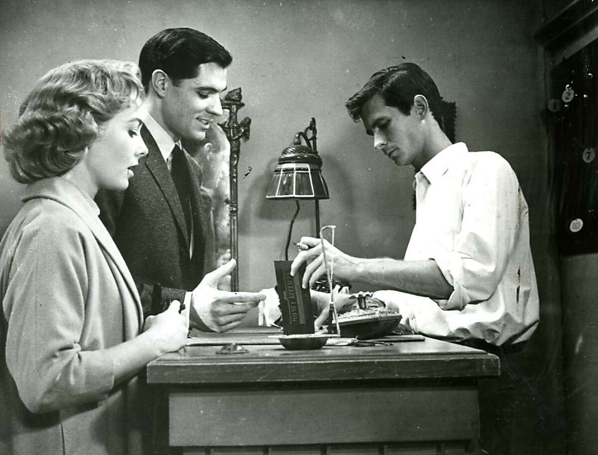 """Anthony Perkins checks guests in near the beginning of the 1960 movie """"Psycho."""""""