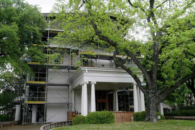 Scaffolding surrounds the back entrance to the Governor's Mansion in Austin, Texas on Tuesday, April 13, 2010. The State Preservation Board  proposed plans for adding to this part of the building during a renovation and restoration following a fire that heavily damaged it in June 2008. Photo: AP
