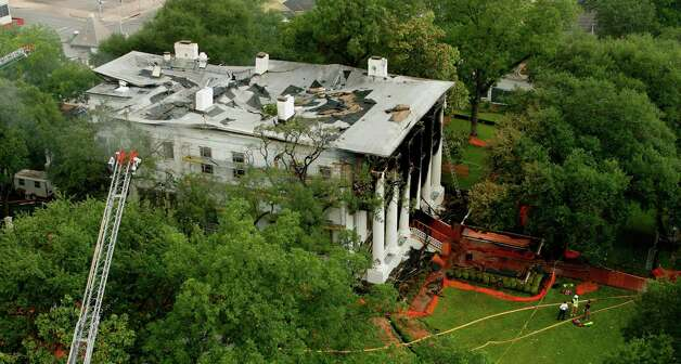 "The historic Texas Governor's Mansion is shown early Sunday, June 8, 2008, in Austin, Texas, after a fire swept through it earlier in the morning. The fire left much of the 150-year-old home charred and inflicted damage that state officials described as ""bordering on catastrophic."" No one was inside at the time and the cause of the blaze is unknown. The mansion had been undergoing a $10 million renovation. Photo: Harry Cabluck, AP / AP"