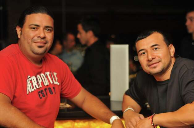Cristyan Hernandez and Edwin Palacios are hanging out at the Chart House restaurant, in the Tower of The Americas Photo: Xelina Flores-Chasnoff
