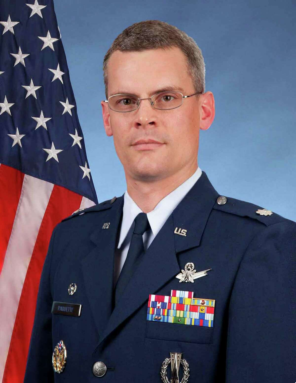 The Air Force onWednesdayrelieved Lt. Col. Mike Paquette, the commander of a basic training squadron that has charged three instructors with having illicit sexual contact with recruits - all of them women.