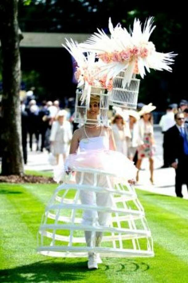 ASCOT, ENGLAND - JUNE 19: Racegoers attend day 1 of Royal Ascot at Ascot Racecourse on June 19, 2012 in Ascot, England.  (Ben Pruchnie / Getty)