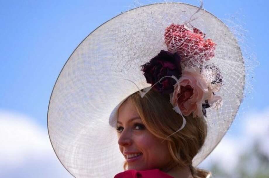A race-goer wearing a flamboyant hat poses for the media at the annual Royal Ascot horse racing event near Windsor, Berkshire on June 19, 2012. The five-day meeting is one of the highlights of global horse racing and the pinnacle of the English social calendar. (Carl Court/AFP / Getty )