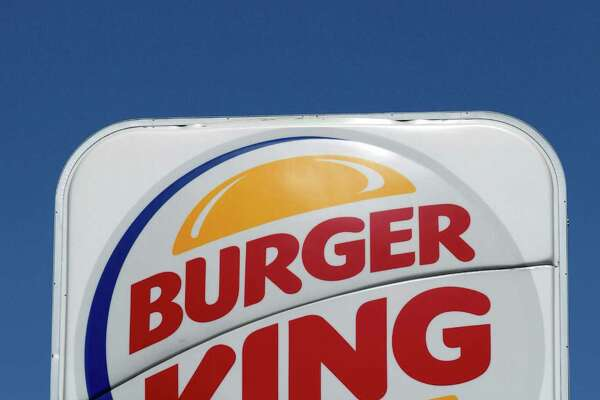 FILE - In a Sept. 2, 2010  file photo,  Burger King franchise logo is seen in Los Angeles.  Burger King, the world's No. 2 hamburger chain, will return to the New York Stock Exchange after the market opens Wednesday, June 20, 2012.   (AP Photo/Damian Dovarganes., File)