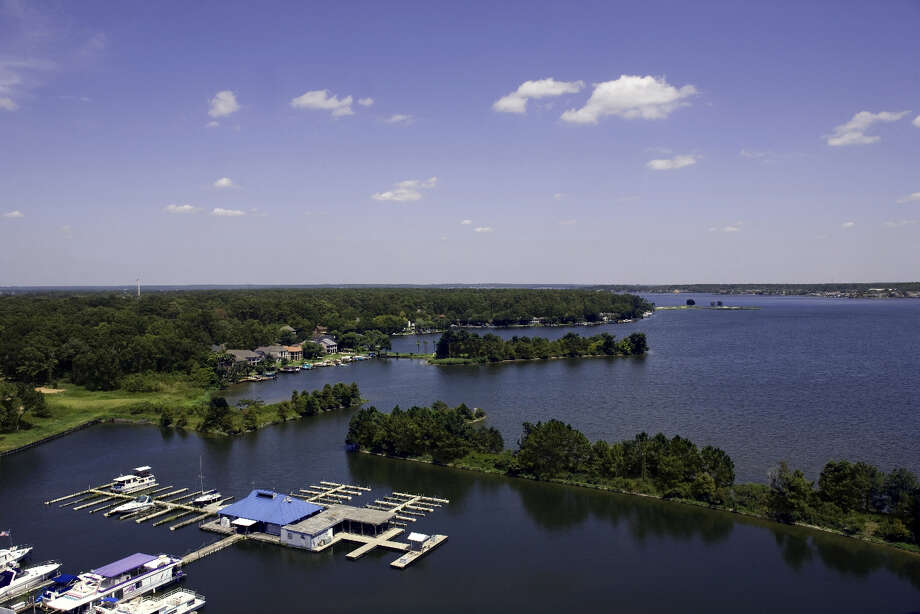 cutline for tower: The view from the hotel tower at La Torretta Del Lago Resort & Spa in Lake Conroe. / Handout Email