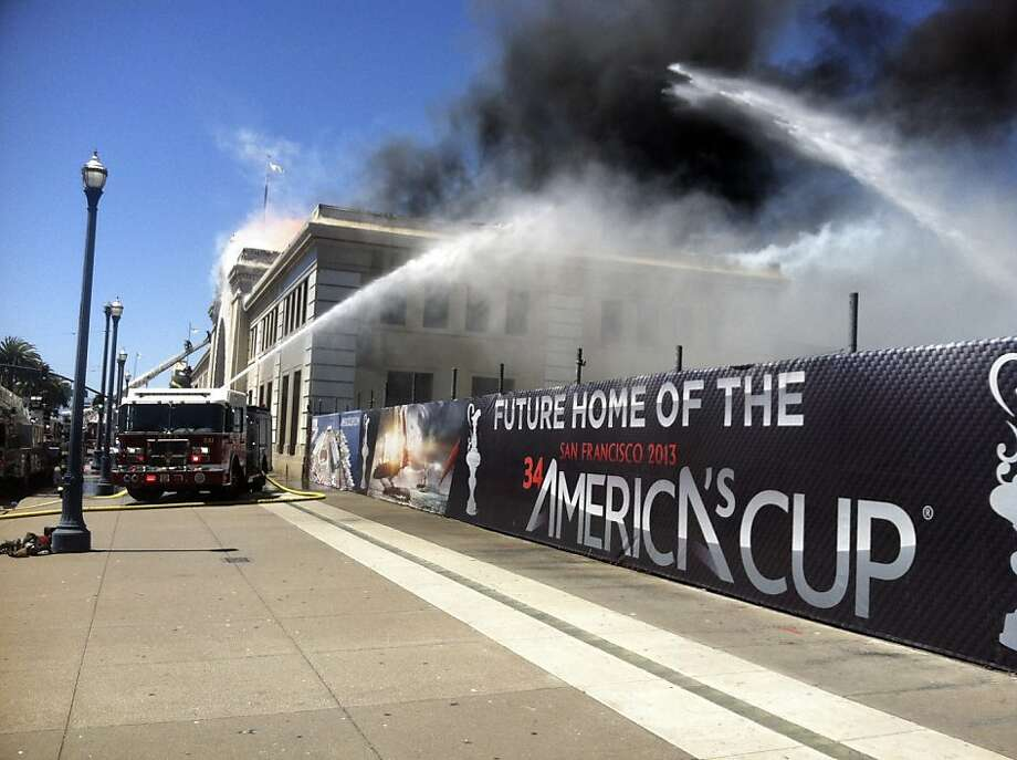Firefighters battle a fire at the Pier 29 building, part of a construction site for next year's America's Cup, in San Francisco, California, U.S., on Wednesday, June 20, 2012. The unoccupied pier building on the Embarcadero waterfront was engulfed in a four-alarm fire, as more than 100 firefighters battled the blaze. Photographer: Marc Perrier/Bloomberg Photo: Marc Perrier, Bloomberg