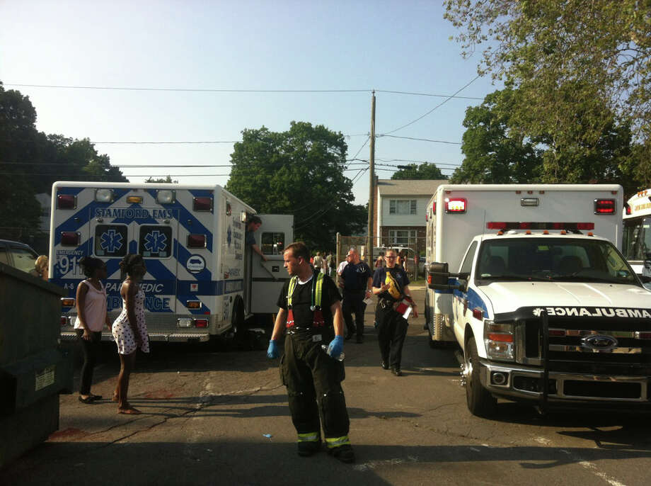 Emergency personnel responds to the Stamford High School graduation where eight people needed to be treated and taken to Stamford Hospital for heat-related injuries. Photo: Maggie Gordon