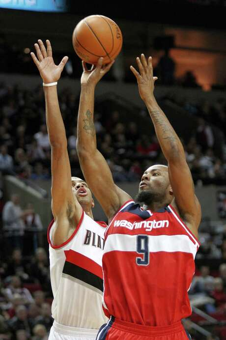 The Wizards saved themselves from spending $13.7 million in a buyout by instead trading Rashard Lewis (right) to the Hornets. Photo: AP