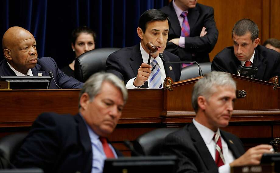WASHINGTON, DC - JUNE 20:  House Oversight and Government Reform Chairman Darrell Issa (R-CA) (C) uses the gavel to ajourn a mark up hearing as ranking member U.S. Rep. Elijah Cummings (D-MD) (L) watches on Capitol Hill June 20, 2012 in Washington, DC. Issa and the committee Republicans voted to hold U.S. Attorney General Eric Holder in contempt of Congress for refusing to hand over documents the GOP says are key to their investigation into the failed Fast and Furious operation. Before the start of the hearing, the White House asserted the documents are protected by executive privilidge.  (Photo by Chip Somodevilla/Getty Images) Photo: Chip Somodevilla, Getty Images