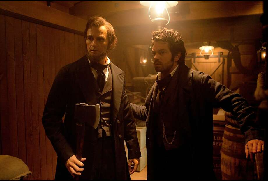 "This film image released by 20th Century Fox shows Benjamin Walker portraying Abraham Lincoln, left, and Dominic Cooper portraying Henry Sturgis in a scene from ""Abraham Lincoln: Vampire Hunter."" (AP Photo/20th Century Fox, Stephen Vaughan) Photo: Stephen Vaughan, Associated Press"