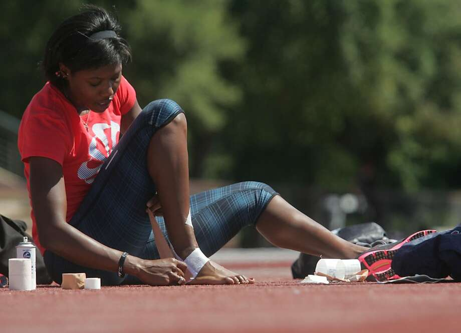 Olympic triple jumper Erica McLain tapes her ankle before practice at Stanford on Wednesday, June 13, 2012. Photo: Mathew Sumner, Special To The Chronicle