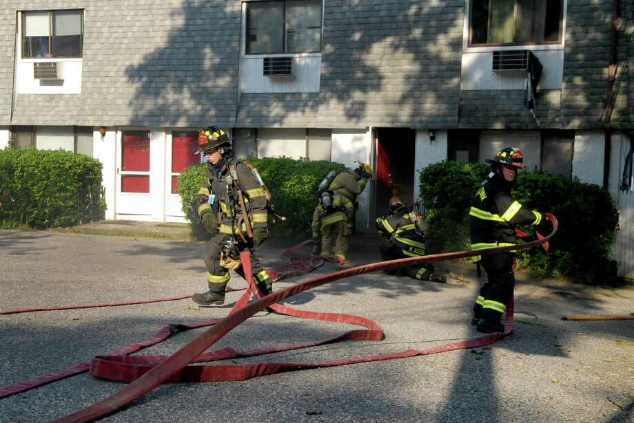 Firefighters respond to a fire at 703 Hope St in stamford, Conn. on Wednesday June 20, 2012. Photo: Dru Nadler / Stamford Advocate Freelance