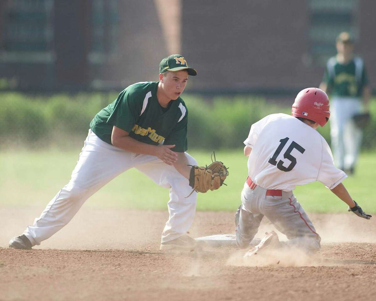 New Milford's Tyler Hansen tags out Pomperaug's Ben Kachur trying to steal second during the Jimmy Fund 13-year-old championship game Tuesday on the Fairfield Hills campus in Newtown.