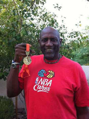 Spencer Haywood, holding his 1968 Olympic basketball gold medal, now lives in Las Vegas.