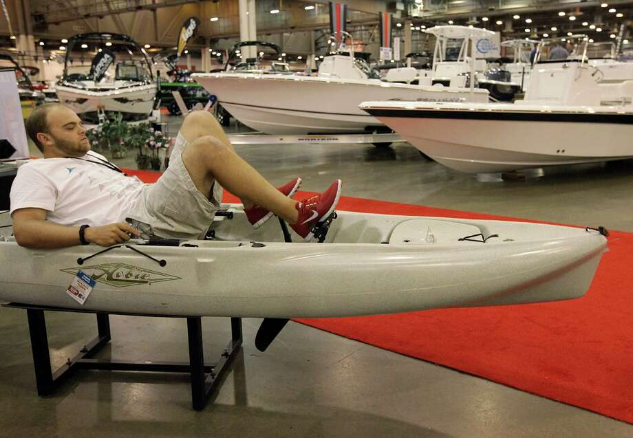 Jerron Wosel, Austin Canoe & Kayak exhibitor, pedals a Hobie Outback kayak during the 25th Annual Houston Summer Boat Show at Reliant Center on Wednesday, June 20, 2012, in Houston. The show features many recreational water vessels such as speed boats, fishing boats, ski and water boarding boats, kayaks, plus RV's. Photo: Mayra Beltran, Houston Chronicle / © 2012 Houston Chronicle