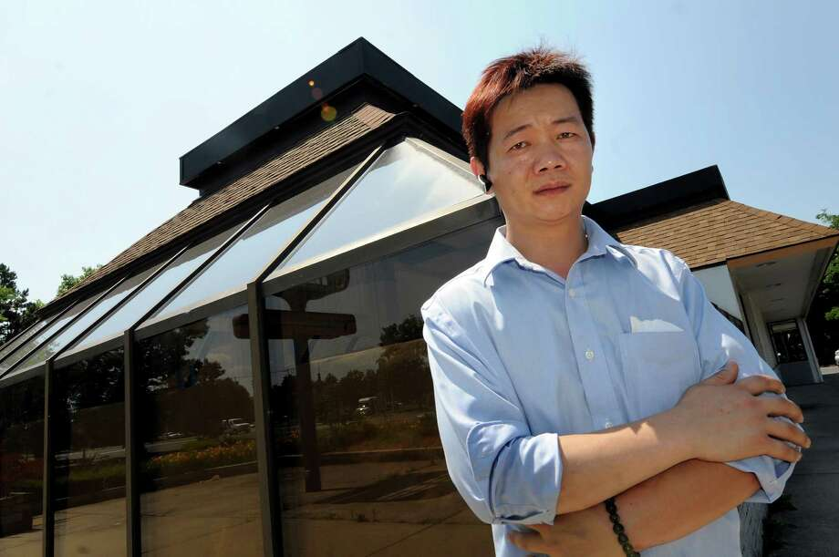 Jerry Zheng, owner of Samurai, a new steakhouse and sushi restaurant being developed out of the old Burger King on Wednesday, June 20, 2012, on Wolf Road in Colonie, N.Y. (Cindy Schultz / Times Union) Photo: Cindy Schultz / 00018177A
