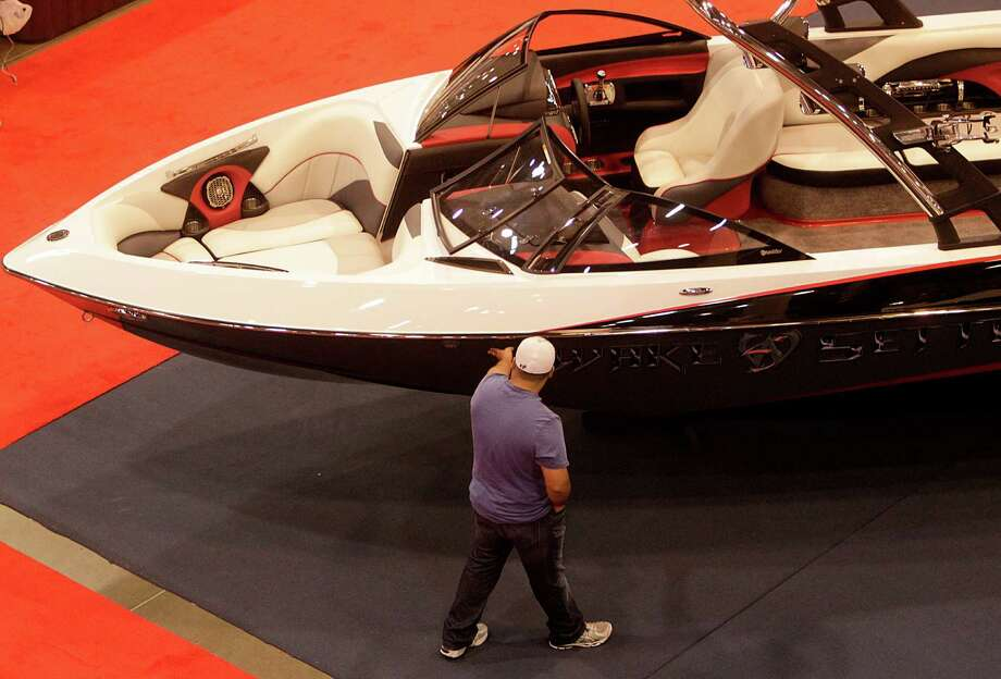 Juan Munoz views a boat while attending the 25th Annual Houston Summer Boat Show. Photo: Mayra Beltran, Houston Chronicle / © 2012 Houston Chronicle