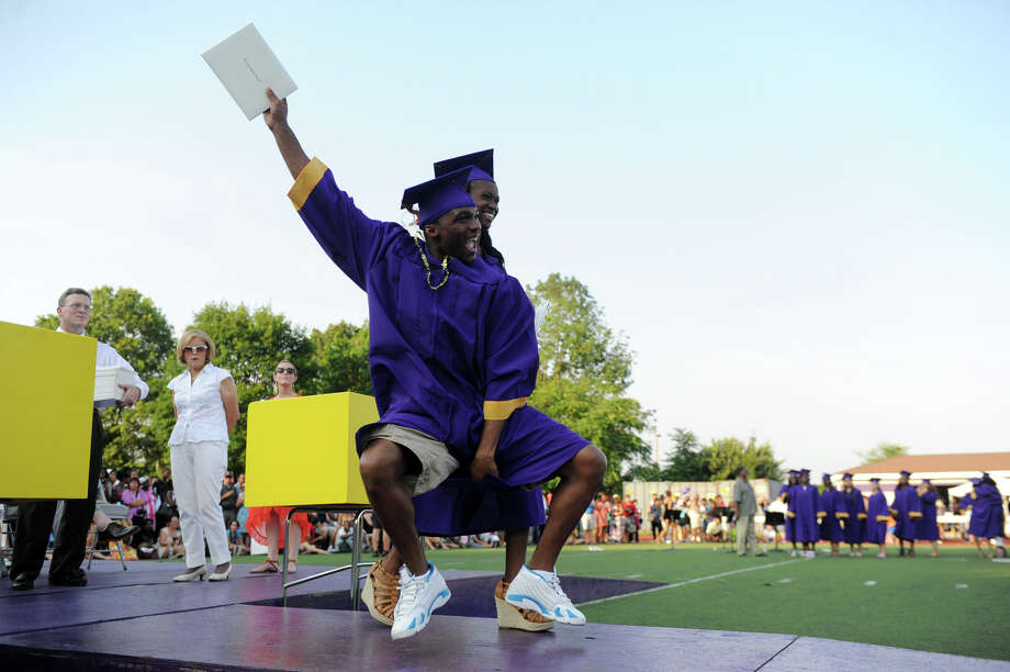Terrance Cromwell celebrates after he and Cynthia Charles collected their diplomas during Westhill High School Class of 2012 Commencement Exercises in Stamford, Conn., June 20, 2012. Photo: Keelin Daly / Stamford Advocate