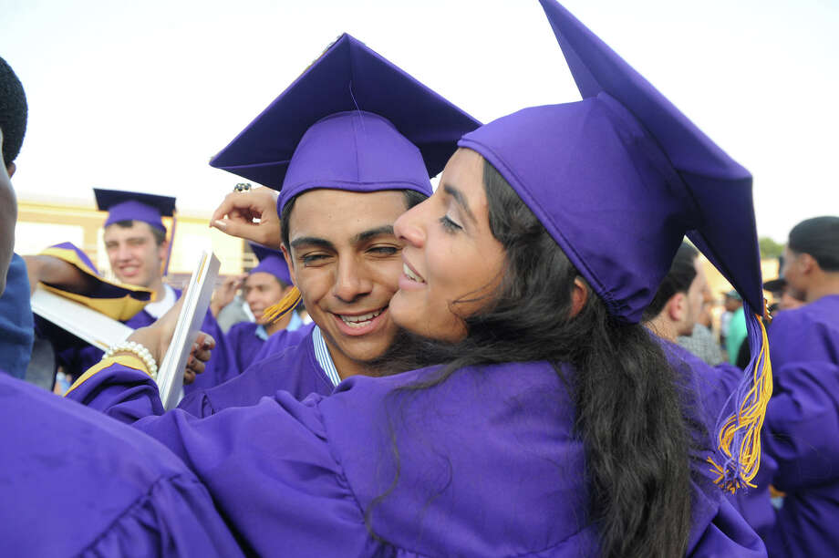 Anthony Martinez and Melissa Mansilla celebrate their graduation after the Westhill High School Class of 2012 Commencement Exercises in Stamford, Conn., June 20, 2012. Photo: Keelin Daly / Stamford Advocate