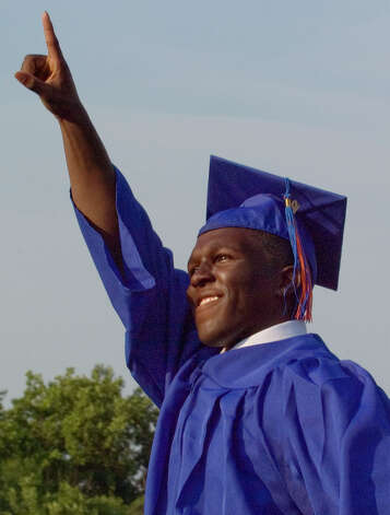 Malcom Leheny waves to family and friedns after receiving his diploma during the graduation ceremony at Danbury High School on Wednesday, June 20, 2012. Photo: Jason Rearick / The News-Times