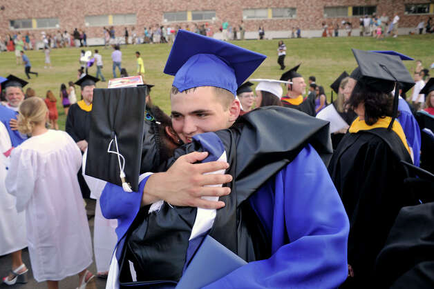 Social studies teacher Louwenta Lewis, left, hugs Kyle Westerfield after the graduation ceremony at Danbury High School on Wednesday, June 20, 2012. Photo: Jason Rearick / The News-Times