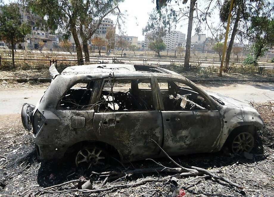 "A handout image released by the Syrian opposition's Shaam News Network shows a charred car in the central flashpoint city of Homs on June 19, 2012. The United Nations is to keep unarmed monitors in Syria despite the escalation of hostilities which led to the suspension of patrols, top UN officials said Tuesday. AFP PHOTO/HO --- RESTRICTED TO EDITORIAL USE - MANDATORY CREDIT ""AFP PHOTO / HO / SHAAM NEWS NETWORK"" - NO MARKETING NO ADVERTISING CAMPAIGNS - DISTRIBUTED AS A SERVICE TO CLIENTS - AFP IS USING PICTURES FROM ALTERNATIVE SOURCES AS IT WAS NOT AUTHORISED TO COVER THIS EVENT, THEREFORE IT IS NOT RESPONSIBLE FOR ANY DIGITAL ALTERATIONS TO THE PICTURE'S EDITORIAL CONTENT, DATE AND LOCATION WHICH CANNOT BE INDEPENDENTLY VERIFIED ----/AFP/GettyImages Photo: -, AFP/Getty Images"